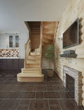 The flight of stairs in the kitchen-dining-room log cabin interi Royalty Free Stock Photo