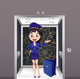 A flight stewardess inside the elevator Stock Images