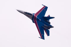 Flight su-27 Flying isolated on white Royalty Free Stock Photography