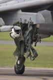 Flight suit on aircraft wheel Stock Image