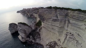 Flight and takeoff over Bonifacio bay area at sunset. Rocks and sea. Corsica, France. Aerial panoramic view. stock video