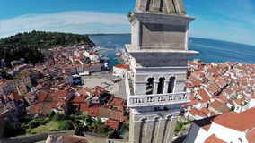 Flight and takeoff over old city Piran, aerial panoramic view. stock footage