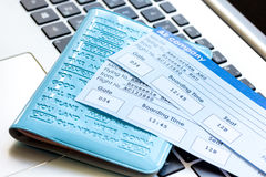 Flight tickets payment online with cards on keyboard. Flight tickets payment online with credit cards on laptop keyboard background Royalty Free Stock Image