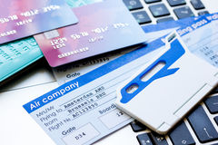Flight tickets payment online with cards on keyboard. Flight tickets payment online with credit cards on laptop keyboard background Stock Images