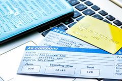 Flight tickets payment online with cards on keyboard. Flight tickets payment online with credit cards on laptop keyboard background Royalty Free Stock Images