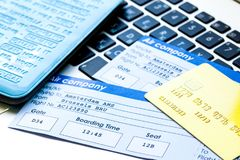 Flight tickets payment online with cards on keyboard. Flight tickets payment online with credit cards on laptop keyboard background Stock Image