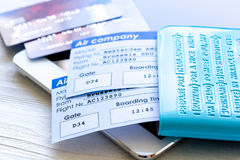 Flight tickets payment online with cards on light wooden table. Flight tickets payment online with credit cards on light wooden table background Royalty Free Stock Image