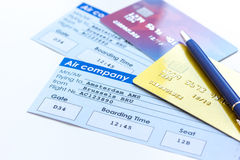 Flight tickets payment online with cards on light wooden table. Flight tickets payment online with credit cards on light wooden table background Stock Photos