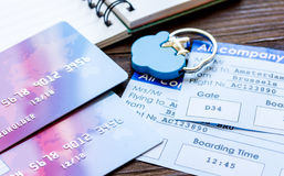 Flight tickets payment online with cards on wooden table. Flight tickets payment online with credit cards and copybook on dark wooden table background Stock Images