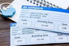 Flight tickets payment online with cards on wooden table. Flight tickets payment online with credit cards and copybook on dark wooden table background Royalty Free Stock Photo