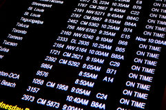 Flight Times. An automated schedule board at George Bush International Airport in Houston, Texas Stock Photo