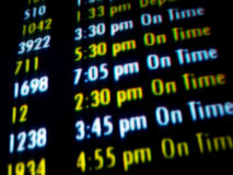Flight Times. A colorful monitor for speeding travelers Royalty Free Stock Image