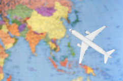 Flight to Asia symbolic image of travel by plane map.  royalty free stock image