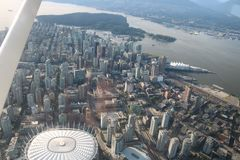 Urban Vancouver flight view cityscapes downtown. On the flight to discovery vancouver city downtown cityscapes stadium building global view of the city until stock photos
