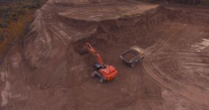 Flight to drone on sand quarry with heavy machinery stock footage