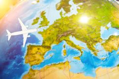 Flight to Europe symbolic image of travel by airplane map. Stock Photo