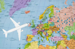 Flight to Europe symbolic image of travel by plane map Royalty Free Stock Photos
