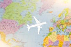 Flight to Europe symbolic image of travel by plane map.  Royalty Free Stock Photo