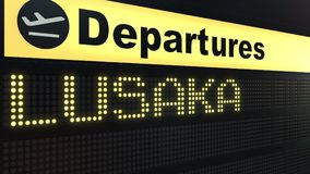 Flight to Lusaka on international airport departures board. Travelling to Zambia conceptual 3D rendering. Flight to Lusaka on international airport departures Royalty Free Stock Images