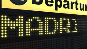 Flight to Madrid on international airport departures board travelling to Spain stock video footage