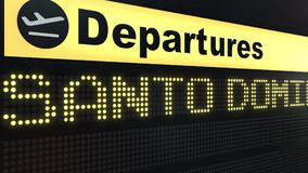 Flight to Santo Domingo on international airport departures board. Travelling to Dominican Republic conceptual 3D.  Stock Image