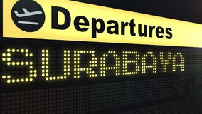 Flight to Surabaya on international airport departures board. Travelling to Indonesia conceptual 3D rendering. Flight to Surabaya on international airport Royalty Free Stock Photography