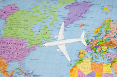 Flight to the USA symbolic image of travel by plane map Stock Images