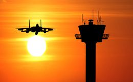 Flight tower and plane Royalty Free Stock Photography