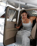 Flight Training Complete. Beautiful woman exiting the pilots seat of a Cessna 172 Royalty Free Stock Photos