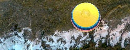 Colorful an yellow ballon above Cappadocia, Turkey royalty free stock images