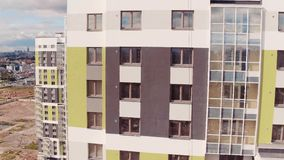 Flight Upward near Residential Multistory Quarters. Aerial view stock footage
