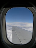Flight view. View from airplane window looking over wing, including window in view Stock Image