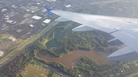 Flight wing span. The flight wing span from the flight window showing ground royalty free stock photography