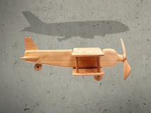 The flight wood airplane with the shadow plane.  Royalty Free Stock Images