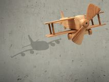 The flight wood airplane with the shadow plane.  Royalty Free Stock Photography