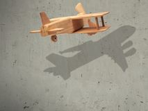 The flight wood airplane with the shadow plane.  Royalty Free Stock Photo