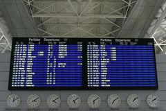Flights information board. In airport terminal Royalty Free Stock Photography
