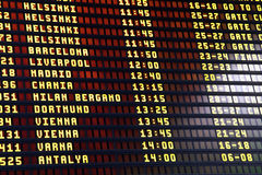 Flights information board in airport terminal Stock Photos