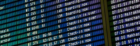 Flights information board in an airport terminal royalty free stock photos