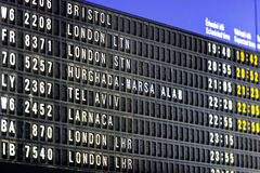 Flights information board in airport terminal perfect for travel. Backgrounds Stock Photos