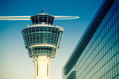 Flights management air control tower passenger terminal and flying plane Royalty Free Stock Photography