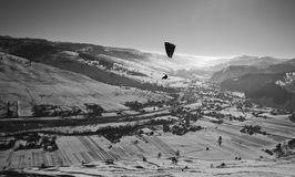 Fligt over Romanian valley. Winter flight over  the Carpathian mountains Royalty Free Stock Photo