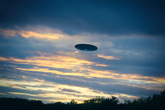 Fliing UFO. A UFO sighting outside on a field