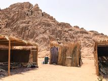 A flimsy, dilapidated decrepit, fragile, fragile poor dwelling, a Bedouin building made of straw, twigs in a sandy hot desert in t. He sand in the parking lot Stock Photos