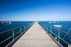 Flinders Back Beach. And pier on a hot summer`s afternoon in the Mornington Peninsula, Victoria, Australia royalty free stock photos
