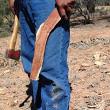 Aboriginal building a boomerang. Flinders Rangers National Park, Australia - February 09, 2002: Building a boomerang in the outback Royalty Free Stock Photos