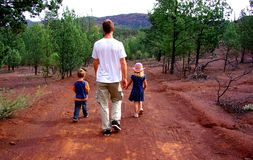 Flinders Ranges Family Hike. A family hiking near the iconic Wilpena Pound in South Australia's Flinders Ranges, photographed from a track near Bunyeroo Gorge stock image