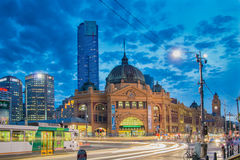 Flinders Street Station in Melbourne at night. With a Melbourne tram in the foreground Stock Image