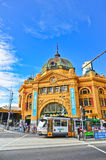 Flinders Street Station and a tram in Melbourne Royalty Free Stock Images