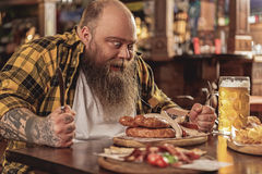 Flingy fat man tasting meal in pub Stock Photo